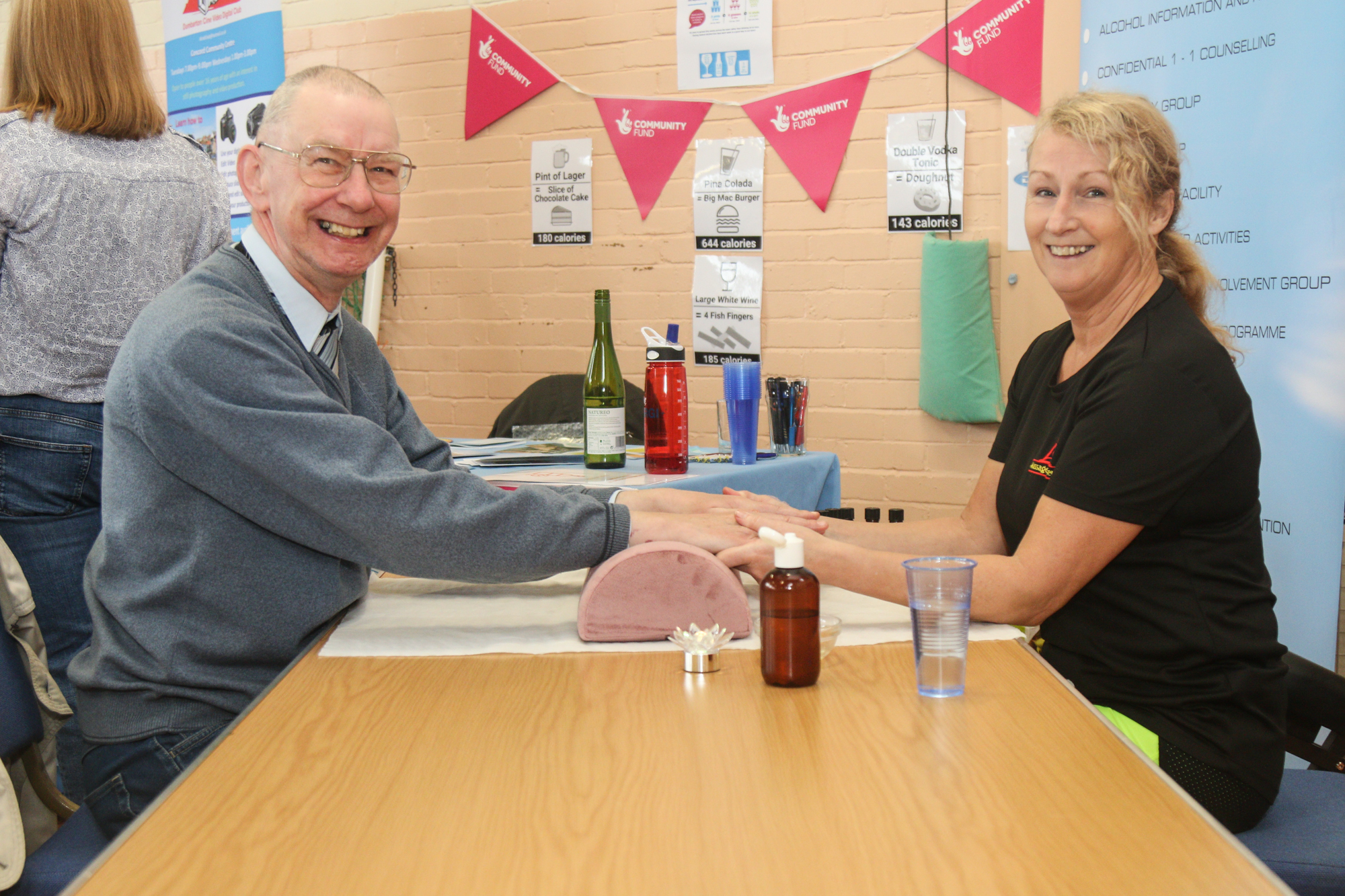 A local resident gets a free hand massage during the Clydesider creative cafe (credit: Robert Wilson)